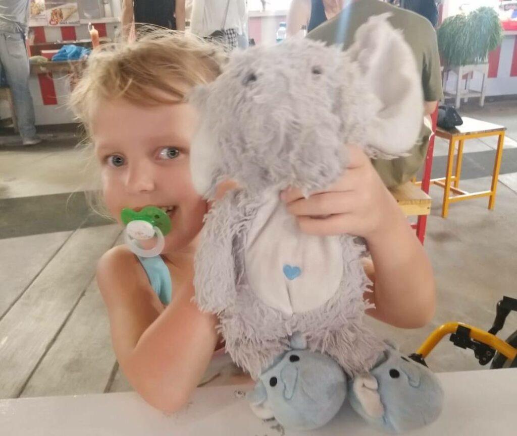 Lotta with her plush elephant